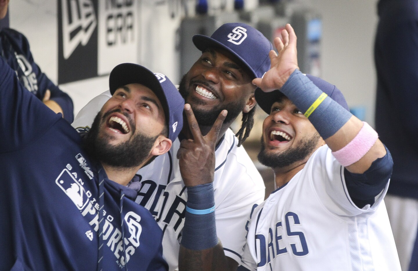 The Padres' Eric Hosmer, left, Franmil Reyes, center, and Fernando Tatis Jr. strike a pose while in the Padres dugout before the start of the Padres' game against the Nationals at Petco Park on Thursday, June 6, 2019 in San Diego, California.