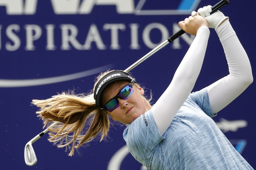 Brooke M. Henderson watches her tee shot on the 17th hole during the third round of the LPGA's ANA Inspiration golf tournament at Mission Hills Country Club in Rancho Mirage, Calif., Saturday Sept. 12, 2020. (AP Photo/Ringo H.W. Chiu)