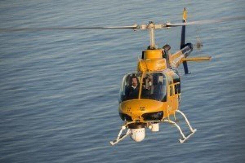 Ruben Campos flies the Sky 10 chopper over the ocean. Photo/Dan Megna Photography