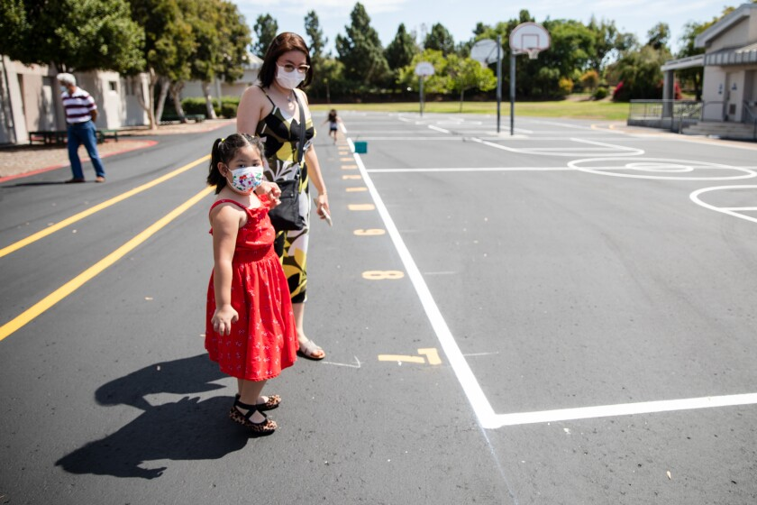 Princess Ada with her daughter, Natalie, 5, attend a back-to-school event at Heritage Elementary Tuesday