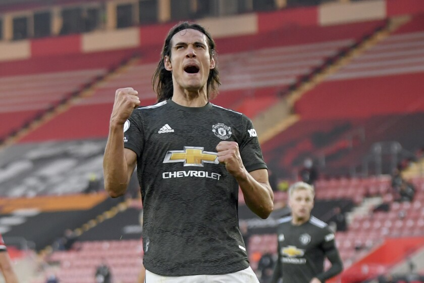 Manchester United's Edinson Cavani celebrates after scoring his side's second goal during an English Premier League soccer match between Southampton and Manchester United at the St. Mary's stadium in Southampton, England, Sunday, Nov. 29, 2020. (Mike Hewitt, Pool via AP)