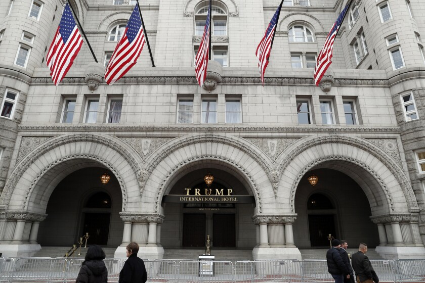 In this photo taken Dec. 21, 2016, the Trump International Hotel in Washington. A Pennsylvania man has been arrested at the Trump International Hotel in Washington after police say they found a rifle and handgun in his car.