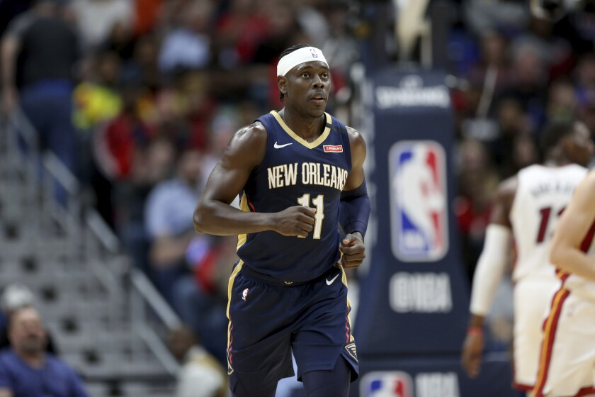New Orleans Pelicans guard Jrue Holiday runs up the court against the Miami Heat in New Orleans on March 6.