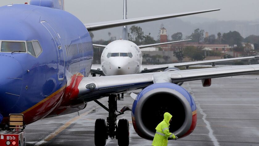 LOS ANGELES, CALIF. DEC. 22, 2016. Jetliners line up to park at gates in Terminal 1 at LAX on Thurs