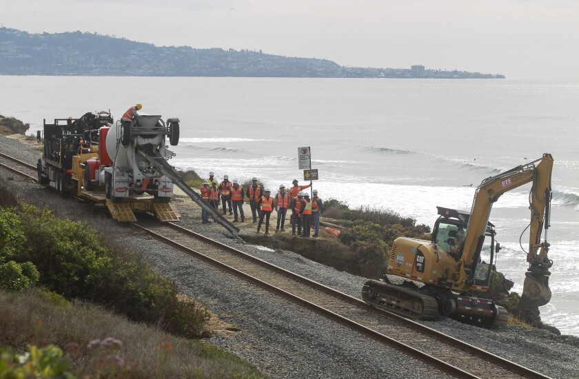 Workers repair erosion caused by a rainstorm in late November along the railroad tracks in Del Mar.