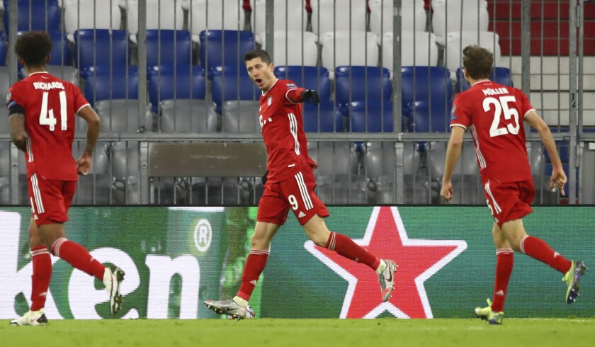 Bayern's Robert Lewandowski, center, celebrates with teammates after scoring his sides first goal during the Champions League Group A soccer match between Bayern Munich and RB Salzburg at the Allianz Arena in Munich, Czech Republic, Wednesday, Nov. 25, 2020. (AP Photo/Matthias Schrader)