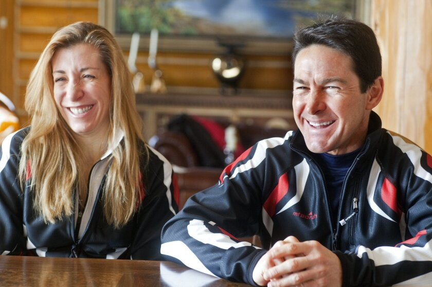 In this photo taken on Monday, Jan. 27, 2014, cross-country skiers Gary and Angelica di Silvestri smile during an interview at the Yellowstone Club in Big Sky, Mont. The American-born man and his Italian-born wife will be representing the tiny Caribbean island nation of Dominica at the Winter Olymp