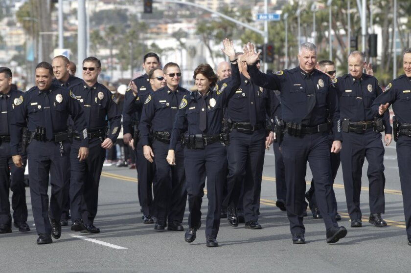 Senior ranking officers from the San Diego Police Department wave to the crowd during the city's annual Dr. Martin Luther King Parade