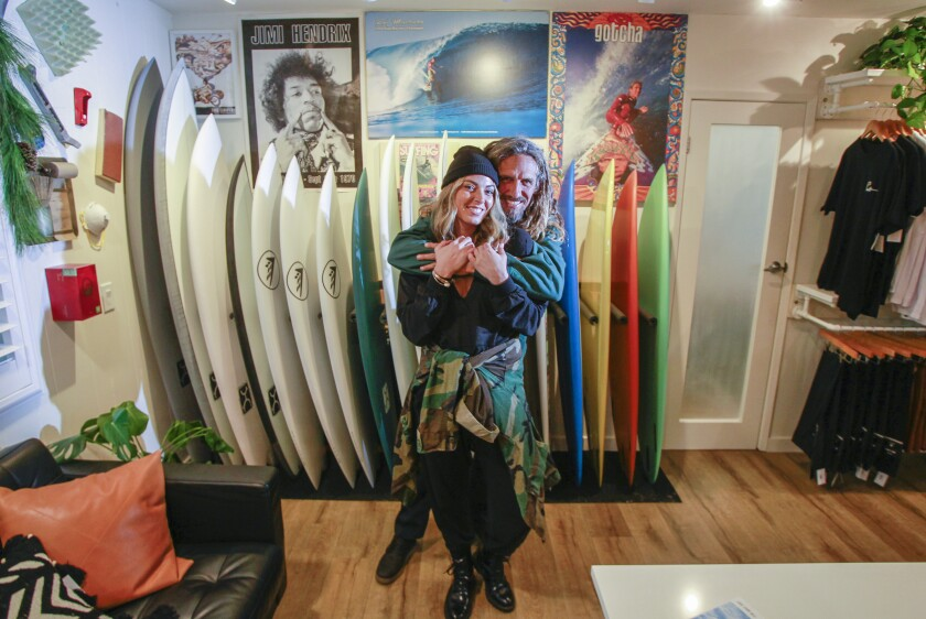 Surfing legend Rob Machado (right) and his wife Sofie Machado pose for photos at The Salty Garage on November 8, 2019 in Encinitas, California. Machado now shapes custom surfboards.