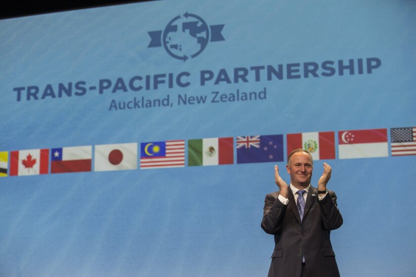 New Zealand Prime Minister John Key clapping during the signing of the Trans Pacific Partnership trade agreement in Auckland, New Zealand, on Feb. 4, 2016.