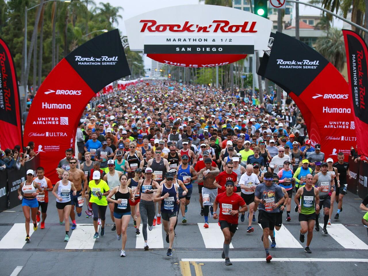 Runners start the Rock 'n' Marathon and Half Marathon along 6th Ave. near Balboa Park in San Diego on June 2, 2019.