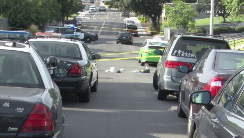 Police taped off a section of 52nd Street in City Heights where a gunman killed a 26-year-old man Friday afternoon.
