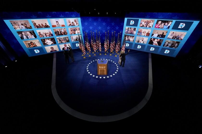 Joe Biden, Jill Biden, Kamala Harris, and Doug Emhoff wave to supporters online at the Democratic National Convention.