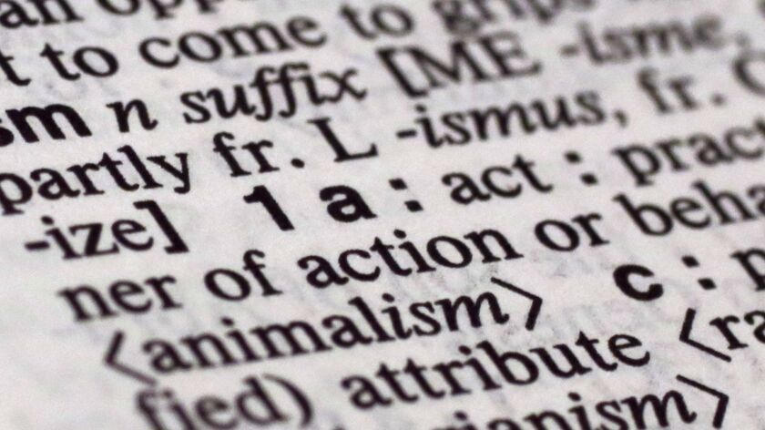 """The suffix """"ism"""" is photographed in Merriam-Webster's Collegiate Dictionary, in New York, Monday, D"""