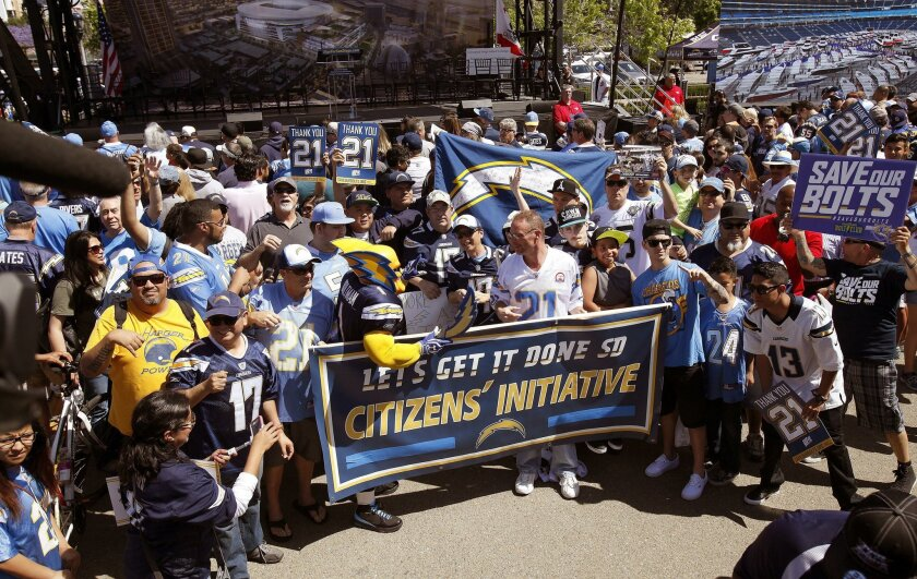 The San Diego Chargers kicked off their Citizens Initiative signature gathering in a parking lot south of Petco Park in April, where fans listened to Chargers majority owner Dean Spanos, NFL commissioner Roger Goodell, LaDanian Tomlinson, Philip Rivers, and others who support a new stadium.