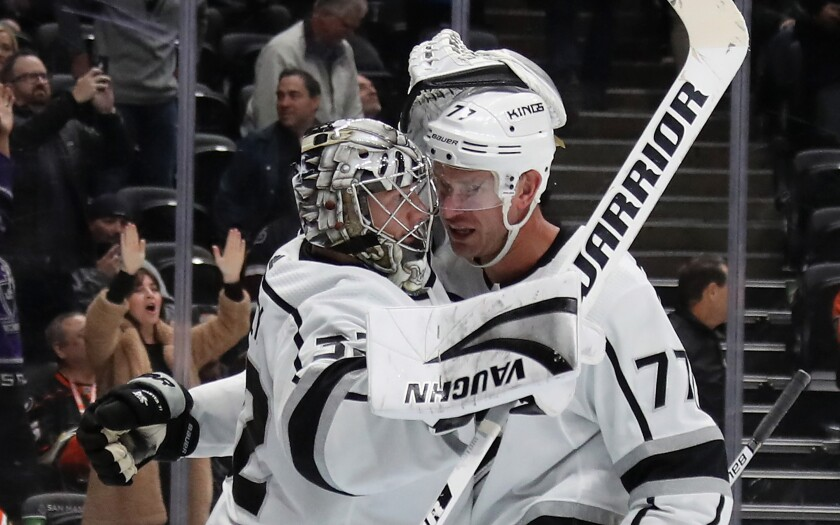 Kings goaltender Jonathan Quick and center Jeff Carter celebrate a 2-1 victory over the Ducks.