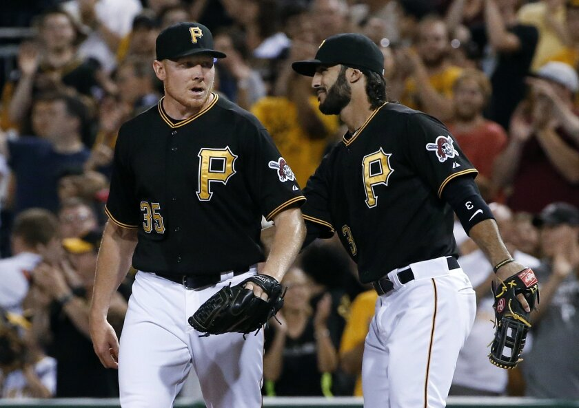 Pittsburgh Pirates closer Mark Melancon, left, celebrates with first baseman Sean Rodriguez after the last out of a baseball game against the Chicago White Sox in Pittsburgh, Tuesday, June 16, 2015. The Pirates won 3-0, with Melancon getting the save. (AP Photo/Gene J. Puskar)