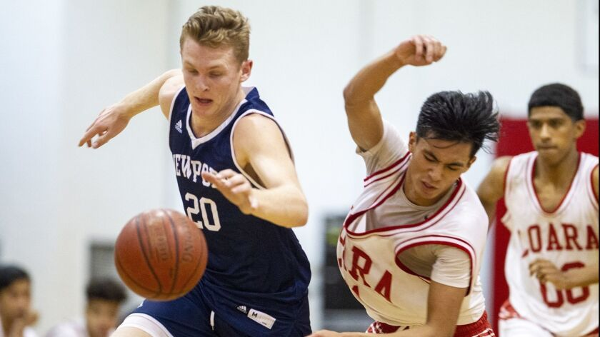 Newport Harbor's Sam Barela battles for a loose ball with Loara's David Lucio during the Grizzly Inv