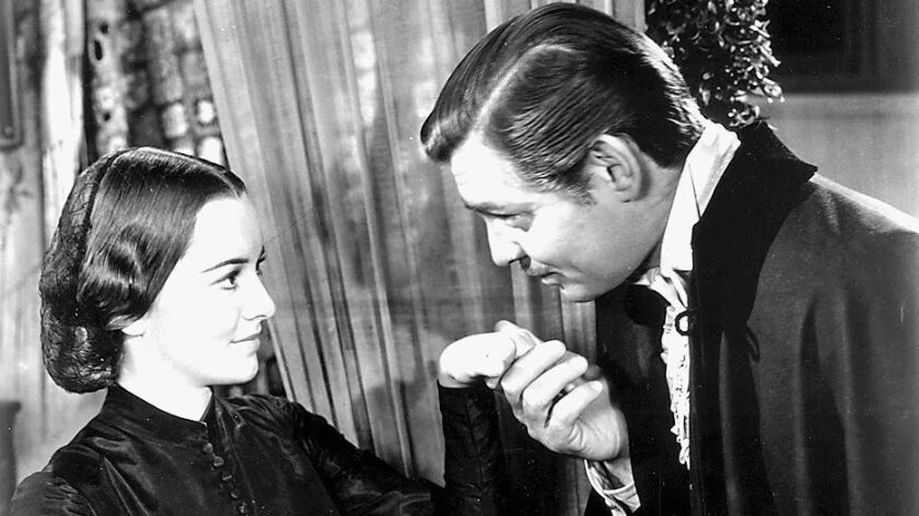 "Olivia de Havilland and Clark Gable star in ""Gone With the Wind."""