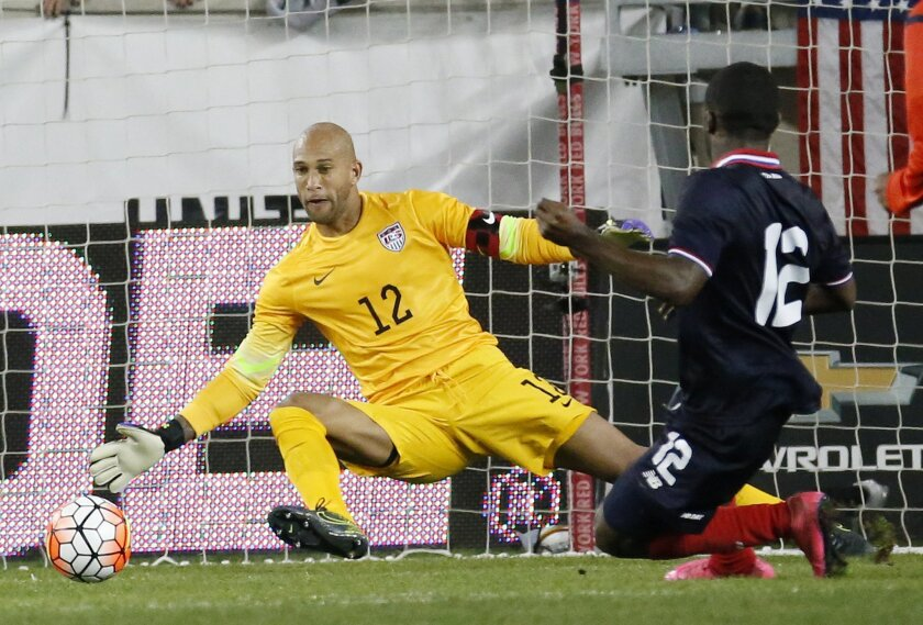 FILE - In this Oct. 13, 2015, file photo, Costa Rica's Joel Campbell, right, scores a goal on United States goalkeeper goalkeeper Tim Howard, left, during the second half of a international soccer friendly match, in Harrison, N.J. Tim Howard or Brad Guzan will play for the United States in next month's World Cup qualifiers against Guatemala despite losing their starting jobs in England's Premier League. (AP Photo/Julio Cortez, File)