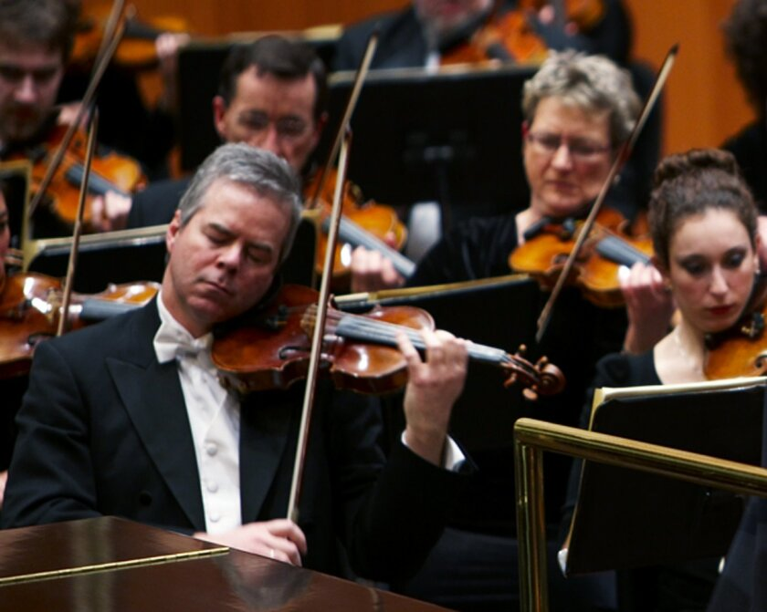 In this undated photo provided by the Milwaukee Symphony Orchestra  concertmaster Frank Almond plays a 300-year-old Stradivarius violin that was on loan to him during a concert in Milwaukee. Police said Wednesday, Feb. 5, 2014, three people have been arrested in connection with the theft of the mul