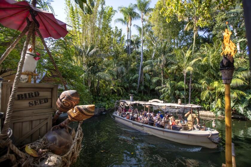 Passengers ride the Jungle Cruise ride at Adventureland in Disneyland.