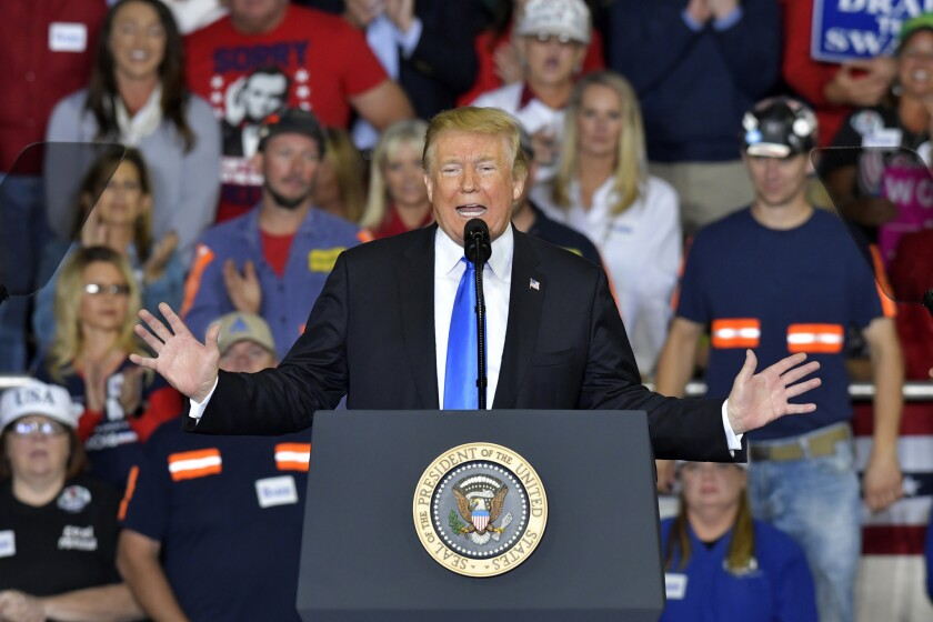 President Donald Trump speaks to a crowd at Eastern Kentucky University, Saturday, Oct. 13, 2018, in Richmond, Ky. (AP Photo/Timothy D. Easley)