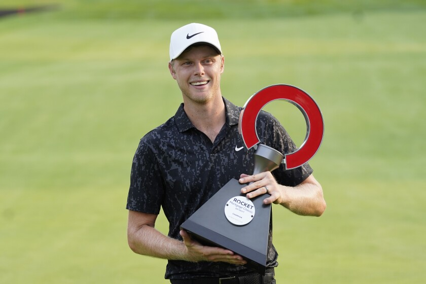 Cam Davis of Australia holds the winner's trophy after the final round of the Rocket Mortgage Classic golf tournament, Sunday, July 4, 2021, at the Detroit Golf Club in Detroit. Davis won on the fifth playoff hole. (AP Photo/Carlos Osorio)