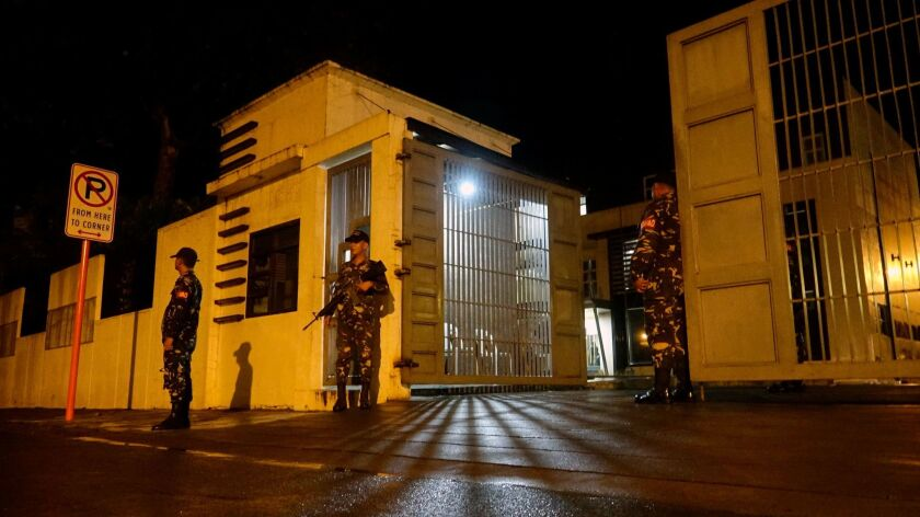 Filipino soldiers stand guard outside a government facility following the declaration of martial law