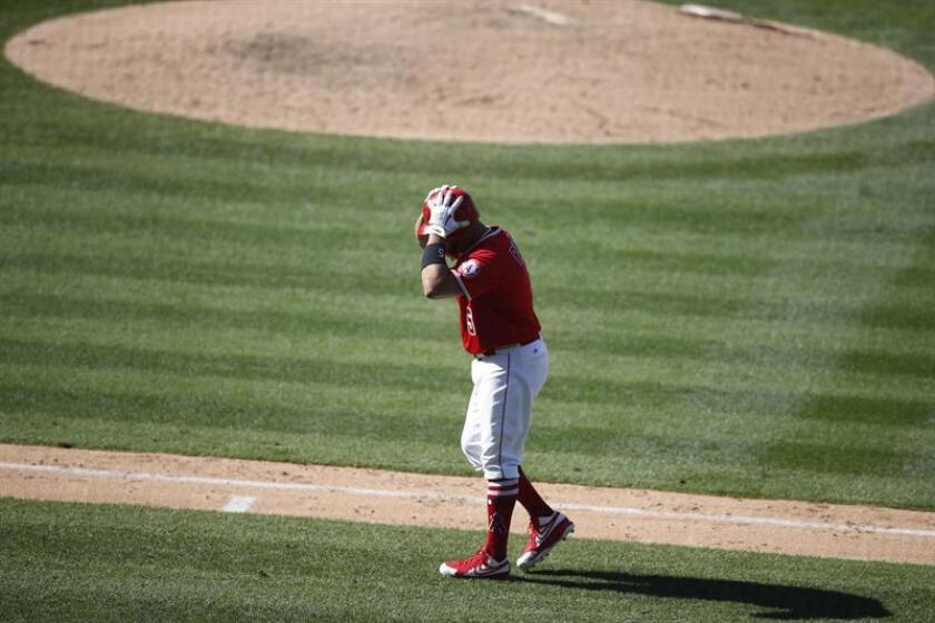 Los Angeles Angels first baseman Albert Pujols from the Dominican Republic reacts after popping out in the tenth inning against the Toronto Blue Jays at Angel Stadium in Anaheim, California, USA, 24 June 2018. EFE
