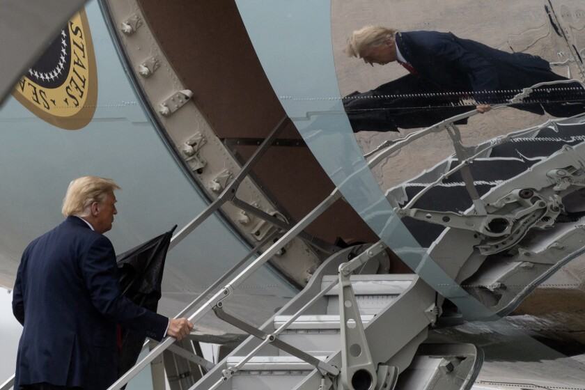 President Donald Trump boards Air Force One, Monday, Oct. 12, 2020.