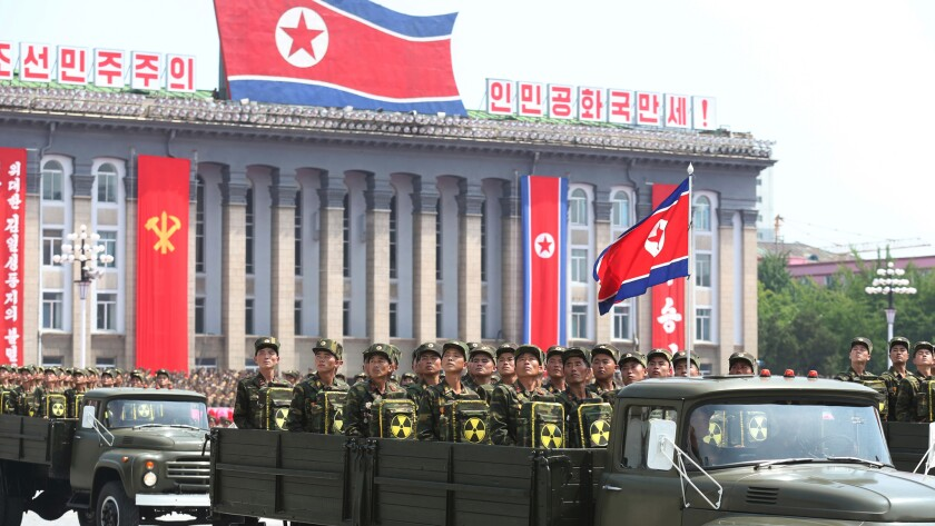 North Korean soldiers turn and look toward leader Kim Jong Un as they parade during a ceremony marking the 60th anniversary of the Korean War armistice in Pyongyang, North Korea, in July 2013.