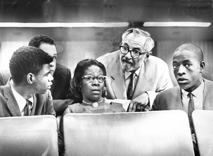 At a state Senate hearing in 1965, Rena Price is flanked by son Marquette Frye, right, whose arrest helped touch off the Watts riots, and stepson Ronald, left. Behind her are attorneys Stanley R. Malone, left, and A.L. Wirin.