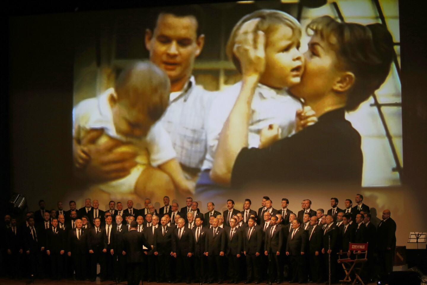 The Gay Men's Chorus of Los Angeles sings during the memorial for Debbie Reynolds and Carrie Fisher near their grave at Forest Lawn Memorial Park-Hollywood Hills.
