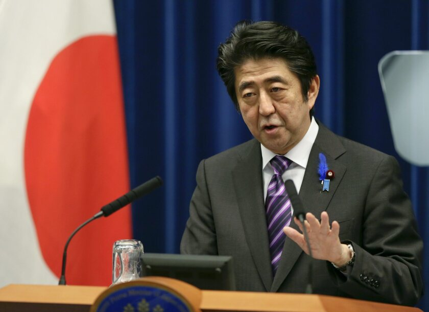 Japanese Prime Minister Shinzo Abe speaks during a news conference in Tokyo.