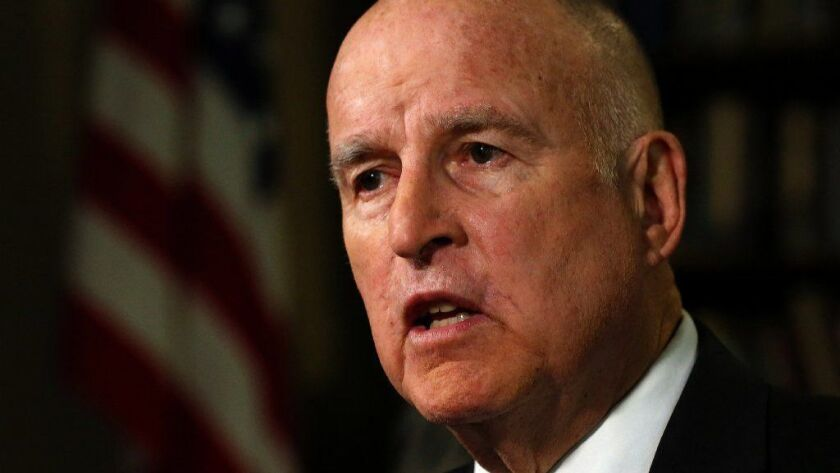 Gov. Jerry Brown signed a measure designed to boost the number of women serving on the boards of publicly held corporations.