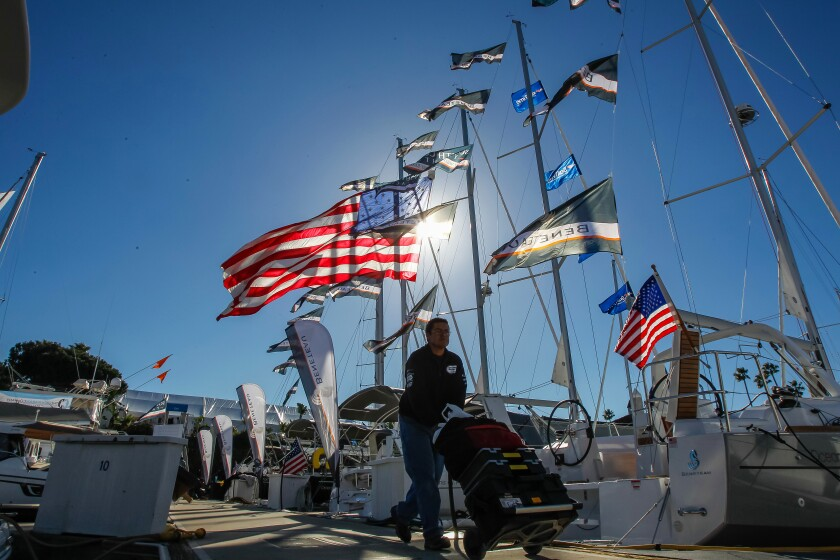 Flags are flying as crews prepare Wednesday for the Sunroad Marina Boat Show on Harbor Island in San Diego, California.