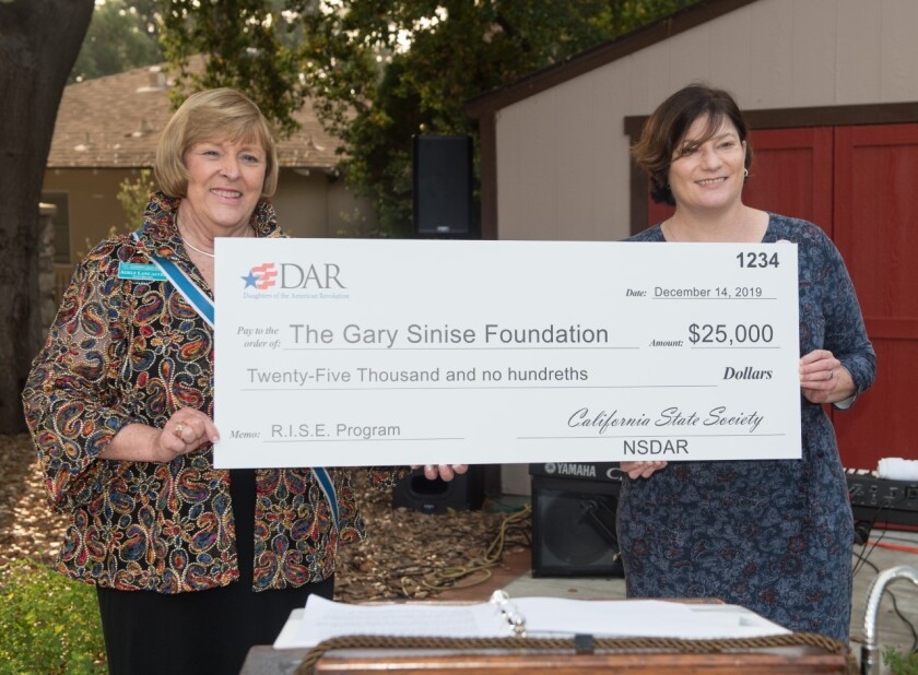 More than 100 chapters of the Daughters of the American Revolution raised $25,000 to help veterans. Local Santa Margarita Chapter, Daughters of the American Revolution, member Adele Lancaster, who serves a regent of the California State Society Daughters of the American Revolution (aka CSSDAR), spearheaded a project with the Gary Sinise Foundation's R.I.S.E. Program to support the construction of a kitchen in one of two homes currently being built for veterans. Funds are being raised through donations from the 115 chapters throughout the state. At a recent event at CSSDAR headquarters in Glendora, a check for $25,000 was presented to Elizabeth Fields, chief operating officer for the Foundation. The check is the first of three that will be presented. The other two are planned to be at least the same amount. The group is hoping to reach $100,000 by the end of April. From left, Adele Lancaster and Elizabeth Fields. The DAR is open to women lineally descended from an ancestor who helped in the fight for independence in the American Revolution. Visit santamargarita.californadar.org.