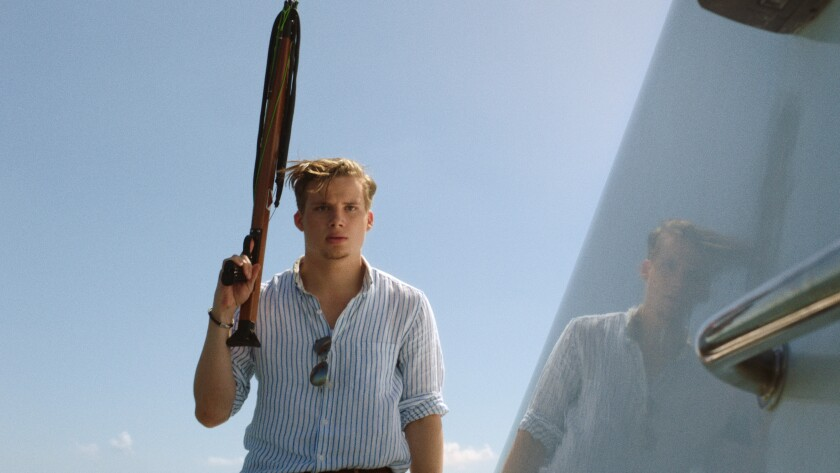 """Christopher Gray holding the titular weapon in """"Harpoon."""""""