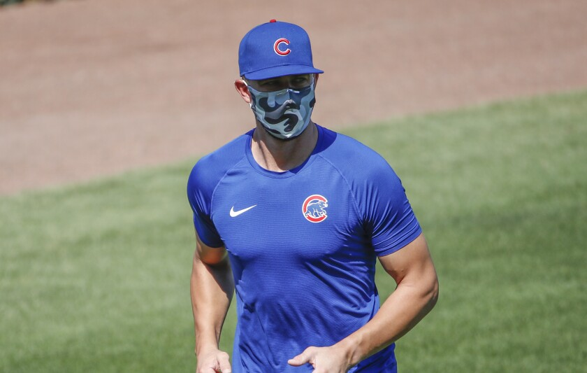 Chicago Cubs third baseman Kris Bryant warms up during baseball practice.
