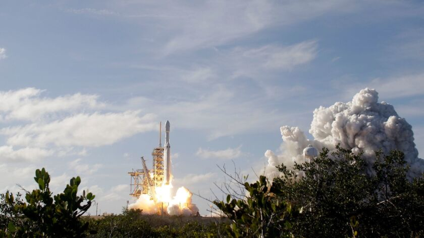 SpaceX's Falcon Heavy rocket lifts off from Launch Pad 39A at Kennedy Space Center in Florida on Feb. 6, 2018.