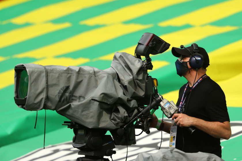 A television camera operator is seen ahead of an English Premier League match.