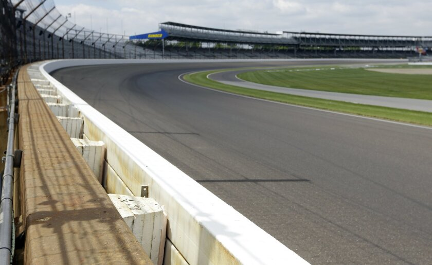 The SAFER (Steel and Foam Energy Reduction) barrier is shown in the first turn at Indianapolis Motor Speedway in Indianapolis, Thursday, May 21, 2015. When James Hinchcliffe slammed into a wall at more than 220 mph, he hit an energy-absorbing barrier that likely saved his life. (AP Photo/Michael Conroy)