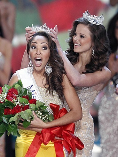 Miss Virginia Caressa Cameron reacts after being crowned Miss America by Miss America 2009 Katie Stam, Saturday Jan. 30, 2010 in Las Vegas.