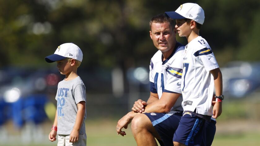 San Diego Chargers quarterback Philip Rivers spends time with his sons during training camp.