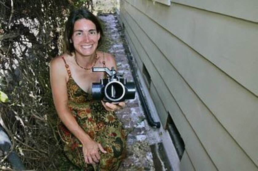 Brook Sarson, showing a diverter valve used at her Talmadge home, called the new rules a great move.  (Eduardo Contreras / U-T)