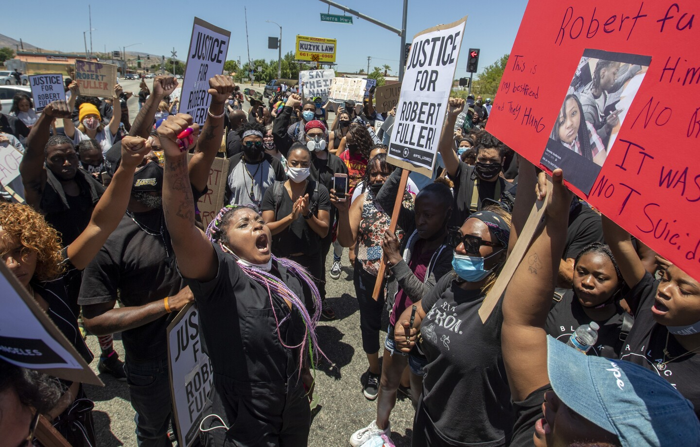 PALMDALE, CA - JUNE 13: Paris Draper, left, leads hundreds of protesters in chants for justice after the death of a young Black man, Robert Fuller, during protest march in Palmdale on Saturday, June 13, 2020 in Palmdale, CA. (Brian van der Brug / Los Angeles Times)