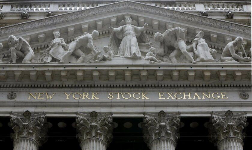 FILE - This Thursday, Oct. 2, 2014, file photo, shows the facade of the New York Stock Exchange. Major stock indexes are creeping higher on Friday, Dec. 19, 2014, as the market comes off a massive t