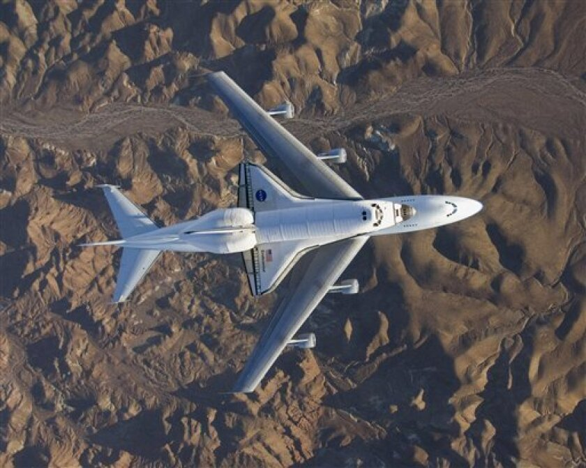 In this image provided by NASA the space shuttle Endeavour, fresh from the STS-126 mission and mounted atop its modified Boeing 747 carrier aircraft, flew over California's Mojave Desert on its way back to the Kennedy Space Center in Florida on Wednesday Dec. 10, 2008. NASA's soon-to-be-retired space shuttles are up for grabs. The space agency said Wednesday Dec. 17, 2008 it's looking for ideas on where and how best to display its space shuttles once they stop flying in a few years. Beware: NASA estimates it will cost about $42 million to get each shuttle ready and get it where it needs to go, and the final tab could end up much more. The estimate includes $6 million to ferry the spaceship atop a modified jumbo jet to the closest major airport. (AP Photo/NASA)