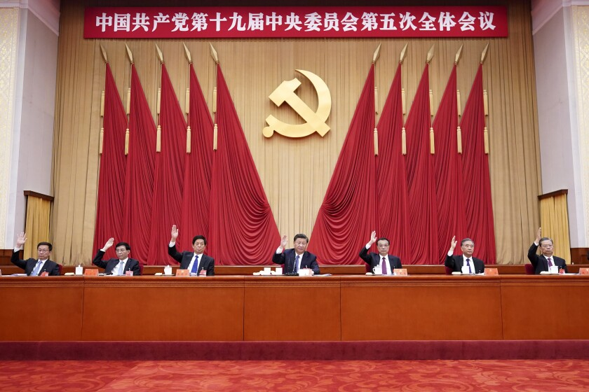 """In this photo released by Xinhua News Agency, Chinese President Xi Jinping, also general secretary of the Communist Party of China (CPC) Central Committee, leads other Chinese leaders attending the fifth plenary session of the 19th Central Committee of the Communist Party of China (CPC) in Beijing, China on Oct. 29, 2020. China's leaders are vowing to make their country a self-reliant """"technology power"""" after a meeting to draft a development blueprint for the state-dominated economy over the next five years. (Wang Ye/Xinhua via AP)"""